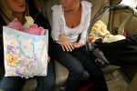 Kaila and Alivia with Xavier in the backseat on the way to the baby shower. The girls call getting pregnant an 'unplanned blessing.'