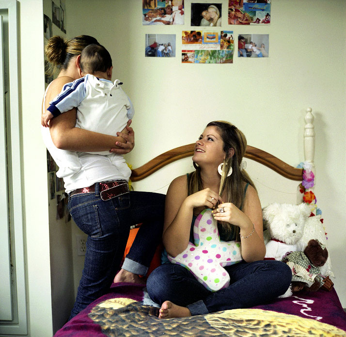 Kaila Simpson, center, in her bedroom with friend Alivia and Alivia's son, Xavier.