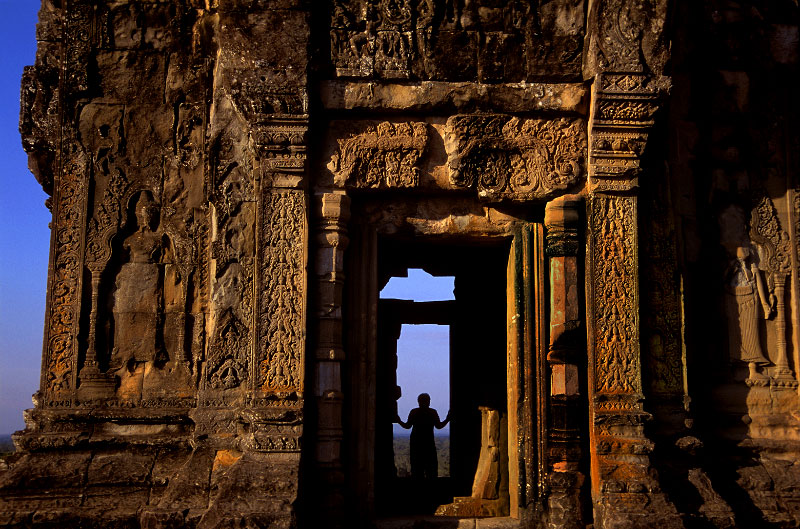 A visitor finds a moment away from the crowds at the 10th century Phnom Bakheng temple.