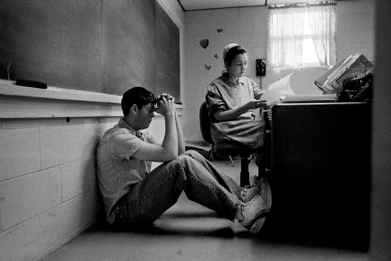 A teacher helps a student prepare for final exams.