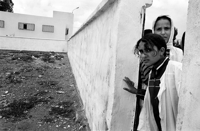 Halima and Najia look out from an entrance to the dormitory grounds, El Hanchane, Morocco