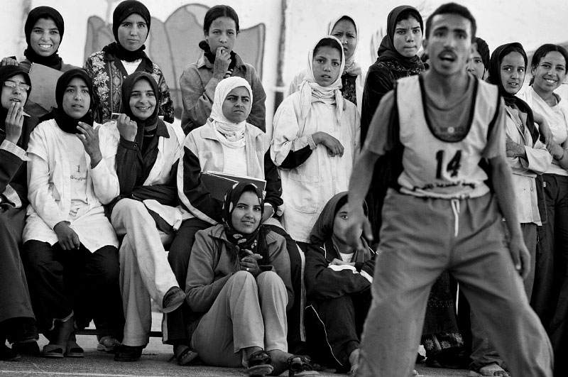 Watching boys' basketball game, El Hanchane, Morocco