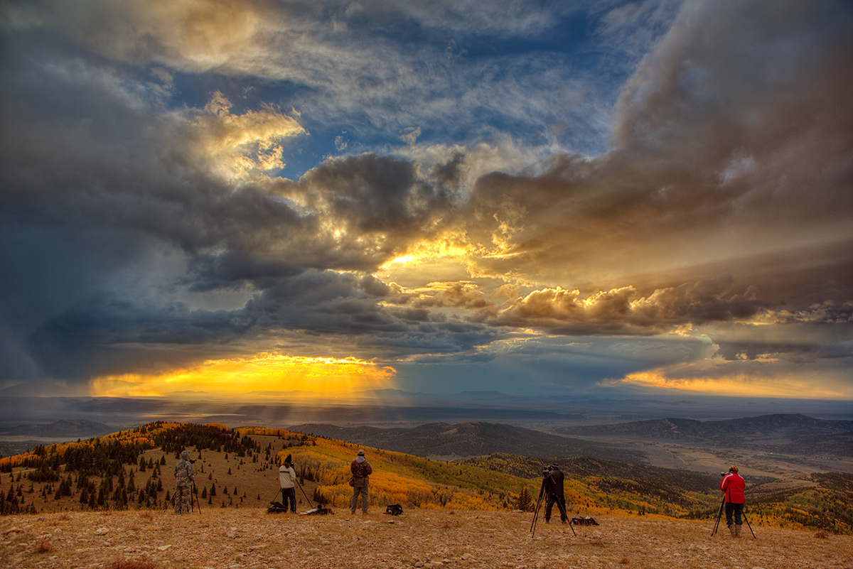 Students in the Colorado Fall Colors Photography Workshop shoot the incredible clouds of unsettled weather from an 11,000 foot mountain peak.
