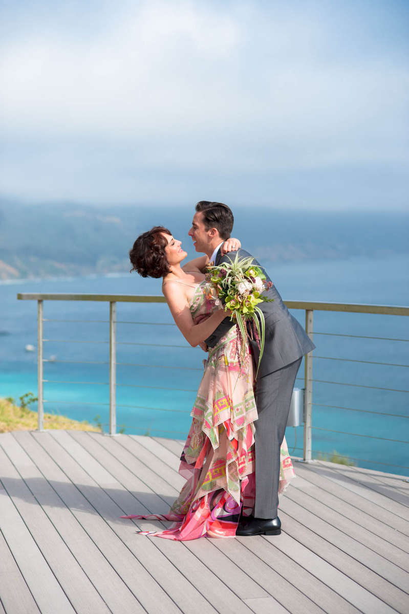 The beautiful pink hues of her dress against that bright blue sea and sky were a photographers dream!