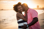 I love the warm light and blurred urban background of this Long Beach maternity shoot