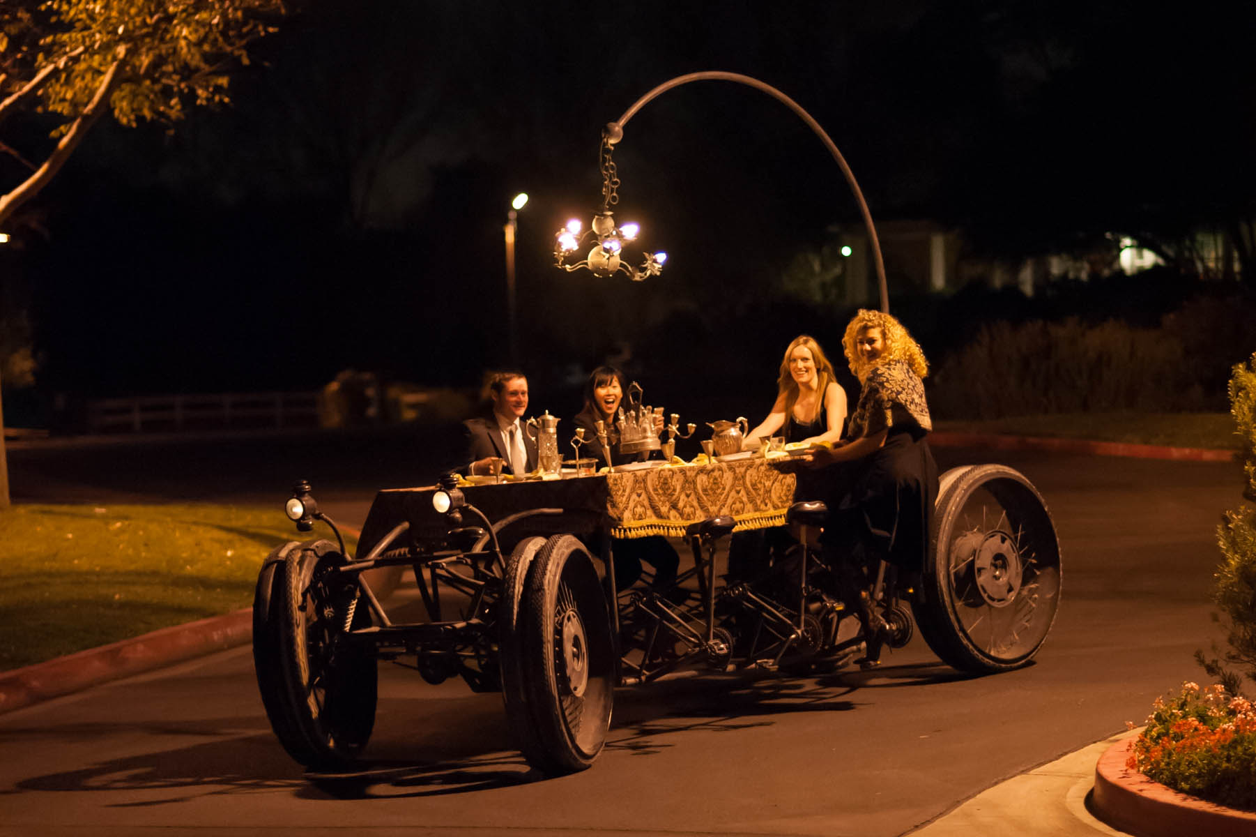 Best wedding dinner table ever! This is the Moveable Feast, a street legal moving dinner table/kinetic sculpture created by the groom!
