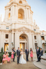 The golden light reflects beautifully off the white walls of Pasadena\'s City Hall, which makes it a popular location for photo shoots!