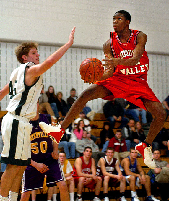 Sauquoit Valley's Isaiah Stanley, right, shoots as Hamilton's Chris Marcellus moves in to try to block the shot during Wednesday night's CSC Exceptional Senior Boys Game at Ilion High School in Ilion, New York.©OBSERVER-DISPATCH/Photo by Marilu Lopez Fretts