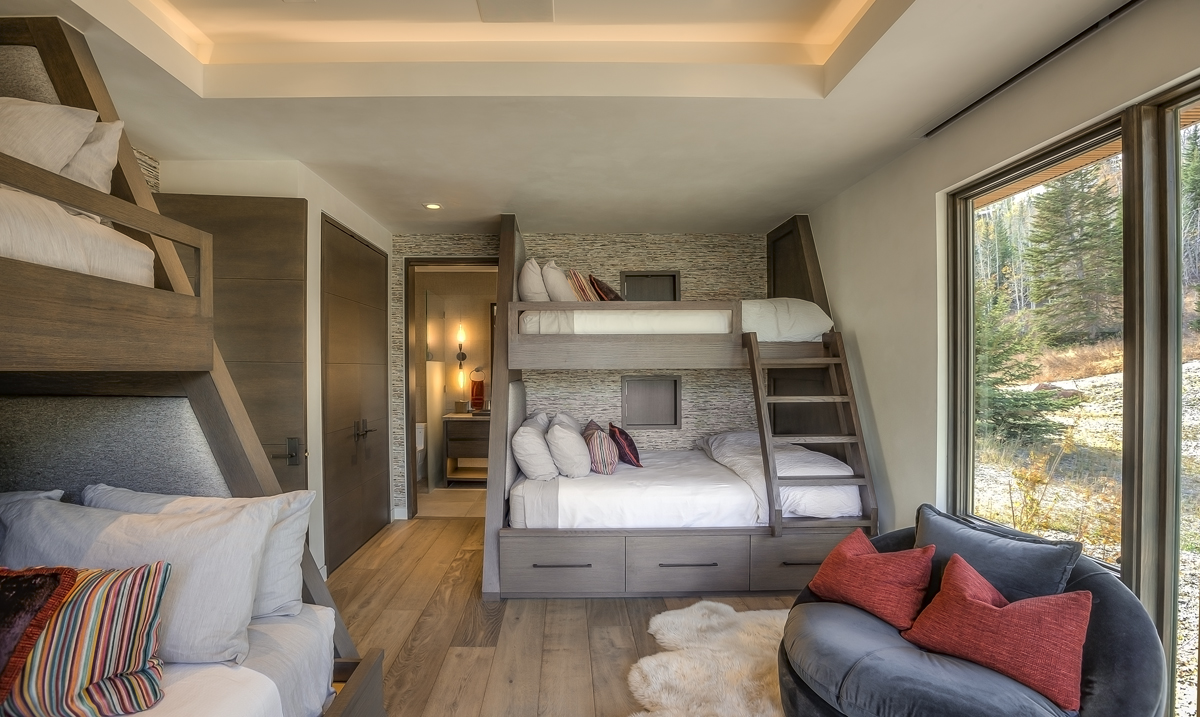 Interior lower level room with bunk beds