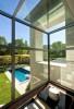 Interior window view of exterior pool