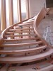 Interior low angle under construction wooden stairwell