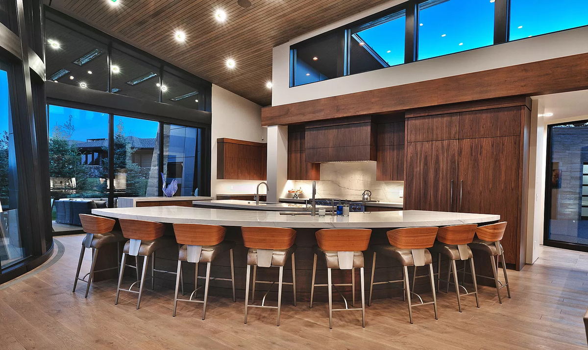 Interior high ceiling view of kitchen with marble bar countertop