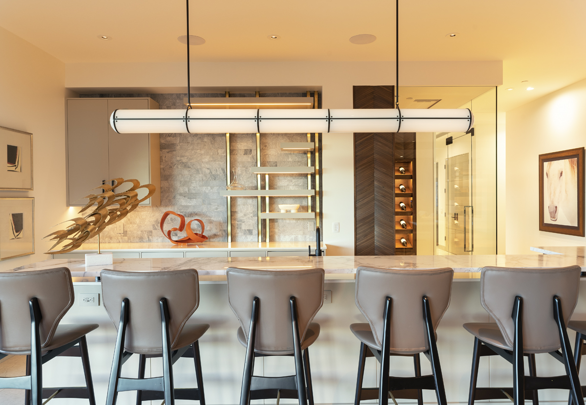 Interior lower level bar with white marble countertops