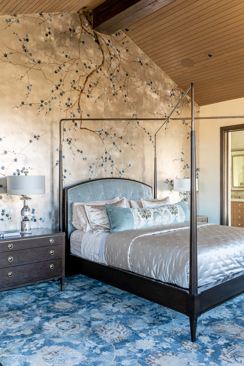Interior view of bedroom with artistic wallpaper