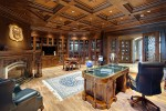 Interior home office with wooden shelving, flooring, and ceiling.