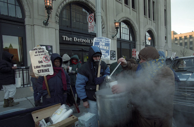 Teamsters Union member Greg Luce of Utica, Mich., ladles some turkey soup from the back of his pickup as hundreds of strikers rallied outside The Detroit News building ona bitter cold Monday, Jan. 15, 1996. Six unions and 2,500 employees struck Detroit Newspapers, publishers of The Detroit News and the Detroit Free Press on July 13, 1995. No talks are in sight as the strike continues into its seventh month.(AP photo by Richard Sheinwald)