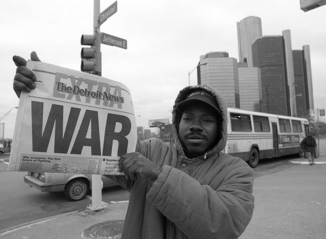 Byron Phillips, 31, of Detroit sells copies of The Detroit News after the United States' surprise attack on Iraq in January 1981.
