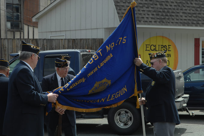 Members of American Legion Post No. 275 of Lansing,  NC, prepare for the flag dedication ceremony at the Ashe County Farmer's Market in West Jefferson, NC, on opening day.