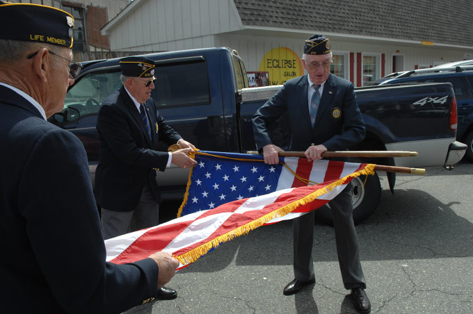 Members of American Legion Post No. 275, Lansing NC, prepare for the flag dedication ceremony at the Ashe County Farmer's Market in West Jefferson, NC, on opening day.