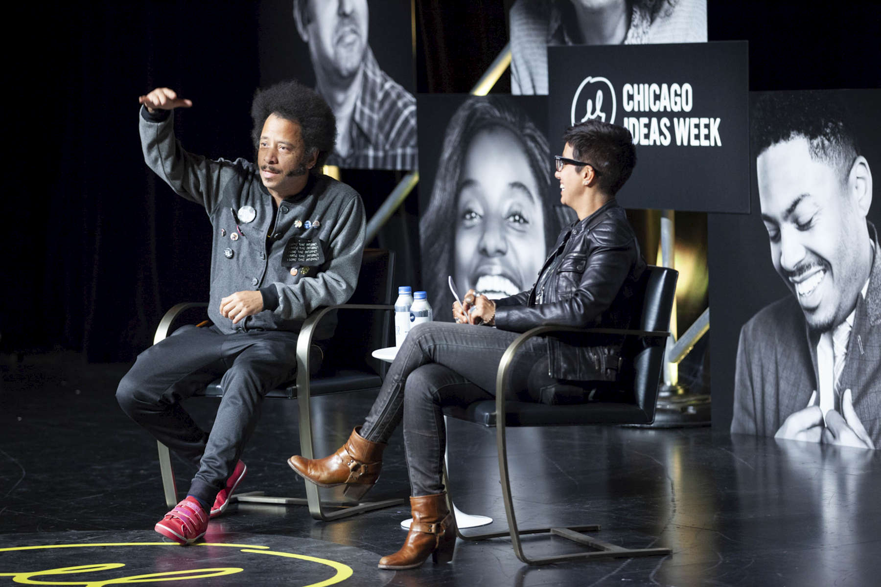 """CHICAGO, IL - OCTOBER 17: Fawzia Mirza,Actor & Writer (right) interviews Boots Riley, Writer & Director (left) during """"Radical Creators: The Cultural Leaders Defining the Zeitgeist"""" at the Edlis Neeson Theater. (Photo by Beth Rooney/Chicago Ideas Week)"""