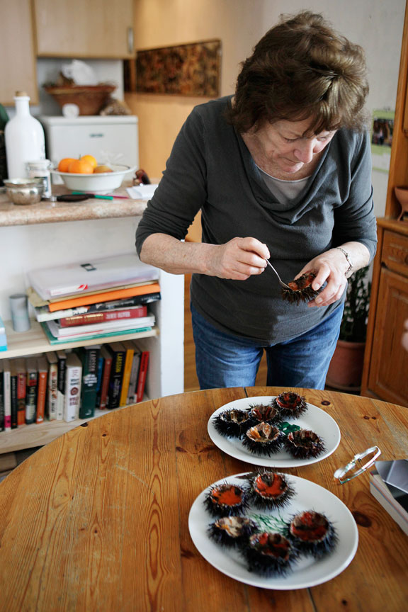 Rolli Lucarotti eating sea urchins in her home in Ajaccio's old city.