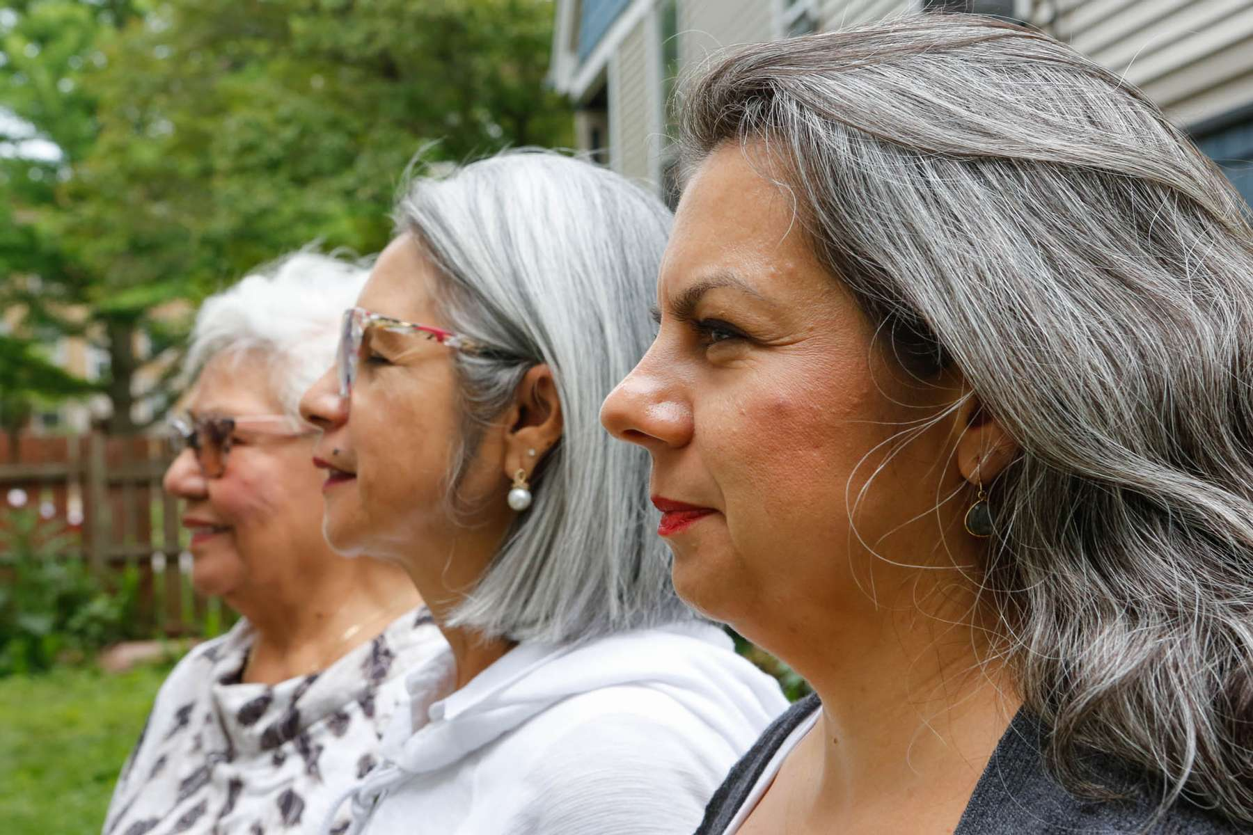 """Rosario Paz, Retired Seamstress, 88.  Luz-Elena Mortensen, Retired Saleswoman, 66. Andrea de Fraga, Documentary Director/Producer, 43.  """"Each of has done something different with our hair. My Abuela just recently stopped dyeing her hair, my mom stopped decades ago, and I just never bothered. My mom had to do a really short haircut when she decided to stop dyeing her hair and I was around 20 at the time and I remember thinking that I could never pull off such a short haircut, so I never started dyeing it,"""" explains Andrea De Fraga."""