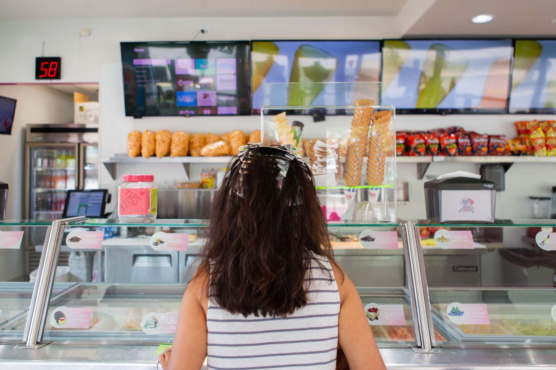 Sona Gajiwala Jones, Business Development, 35.Sona ordering ice cream while she is waiting for her hair to be finished.