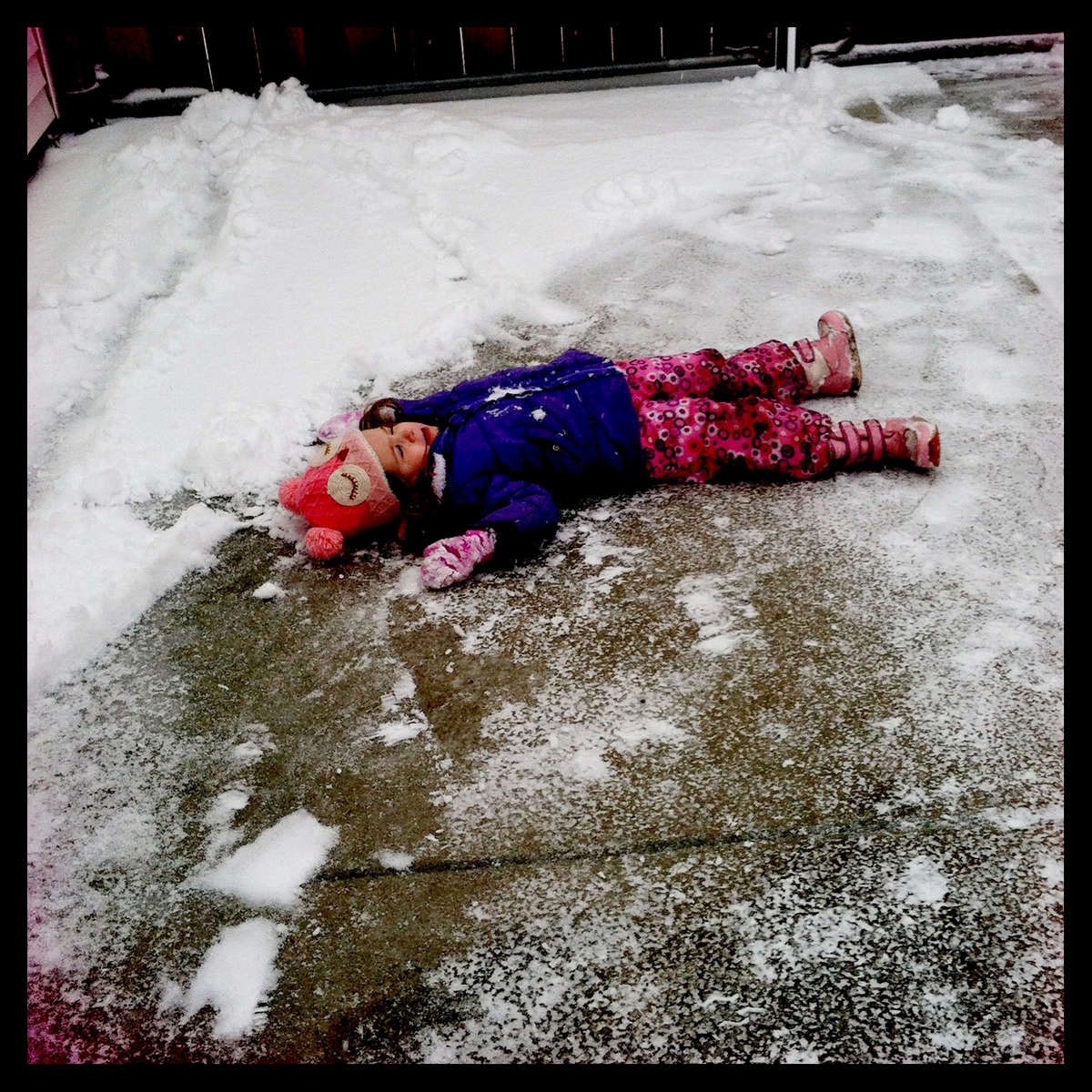Rose lying on the parking pad after falling. She had been {quote}ice skating{quote} before she fell. March 2016.
