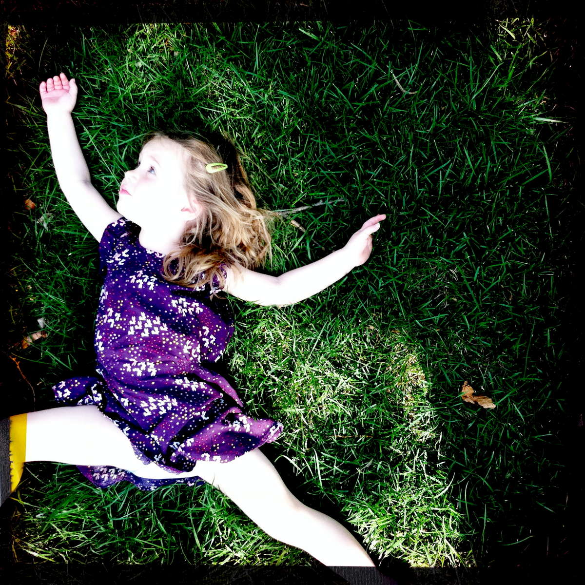 {quote}I'm flying, Mama.{quote} Rose laying on the grass on the way back from school. May 2015.