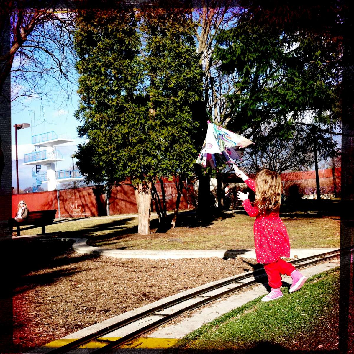 Rose dances with an umbrella she found at the park. March 2016.