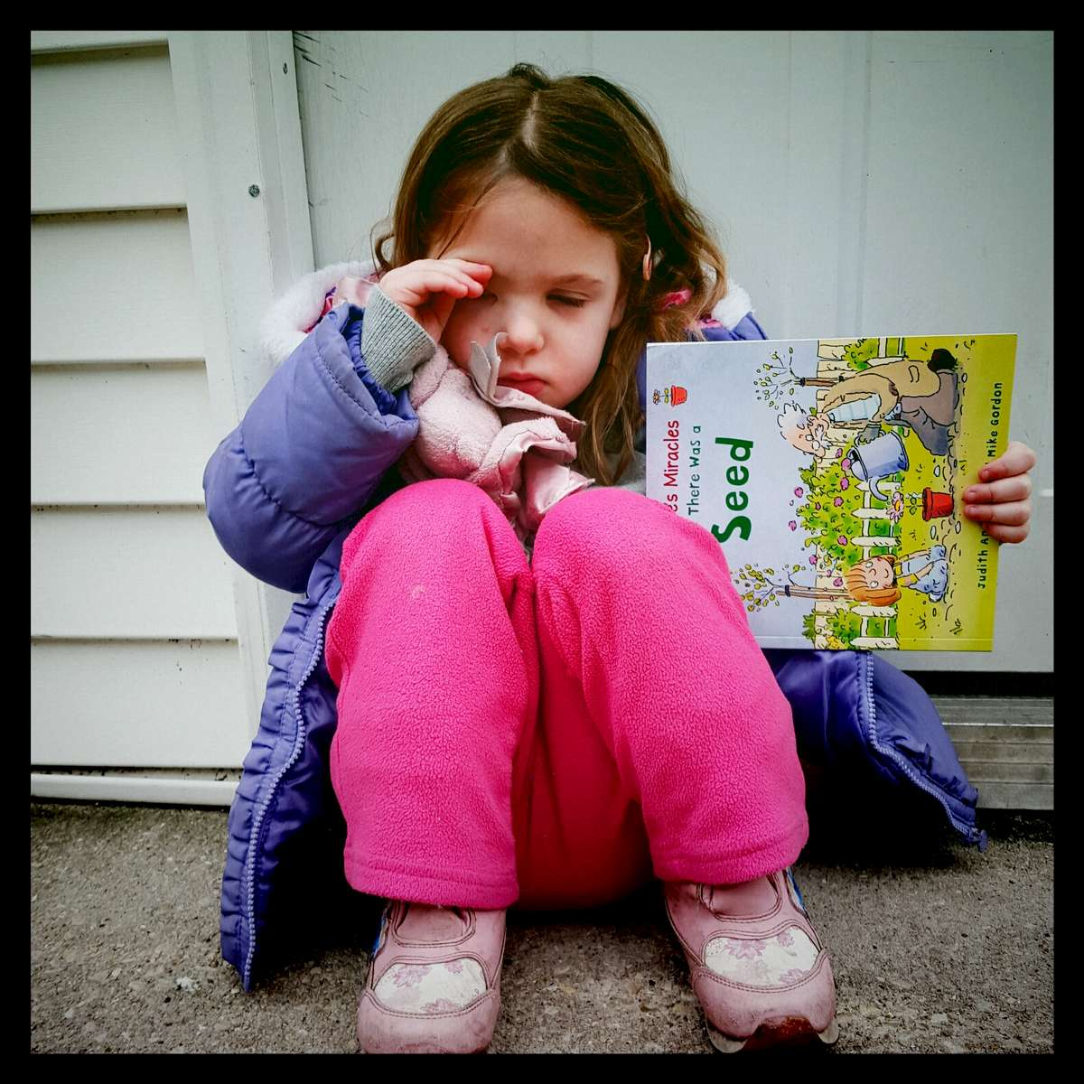 Rose rubbing her eyes after a bad night of sleep. She almost forgot her book for school. March 2016.