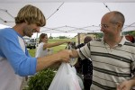 Marty and Crystal Gray  sell produce at the farmers' market in Champaign, Illinois.