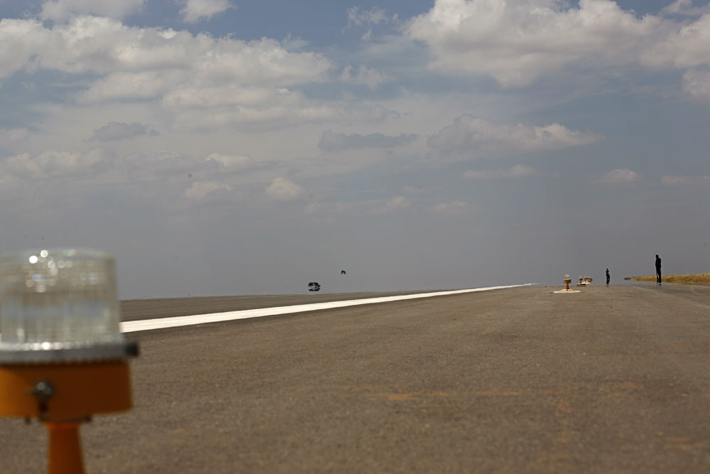 Workers check the runways at the New Bangalore Airport. Construction on the road leading to the airport has fallen behind and will not be ready by the scheduled date of March 25, 2008.