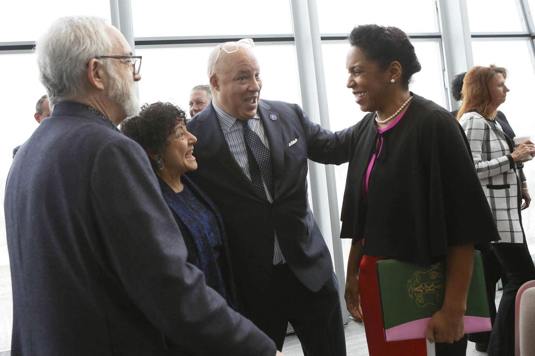 Dr. Whitaker (center) introduces Lt. Govenor Juliana Stratton (right) to Dr. Freada Kapor Klein.