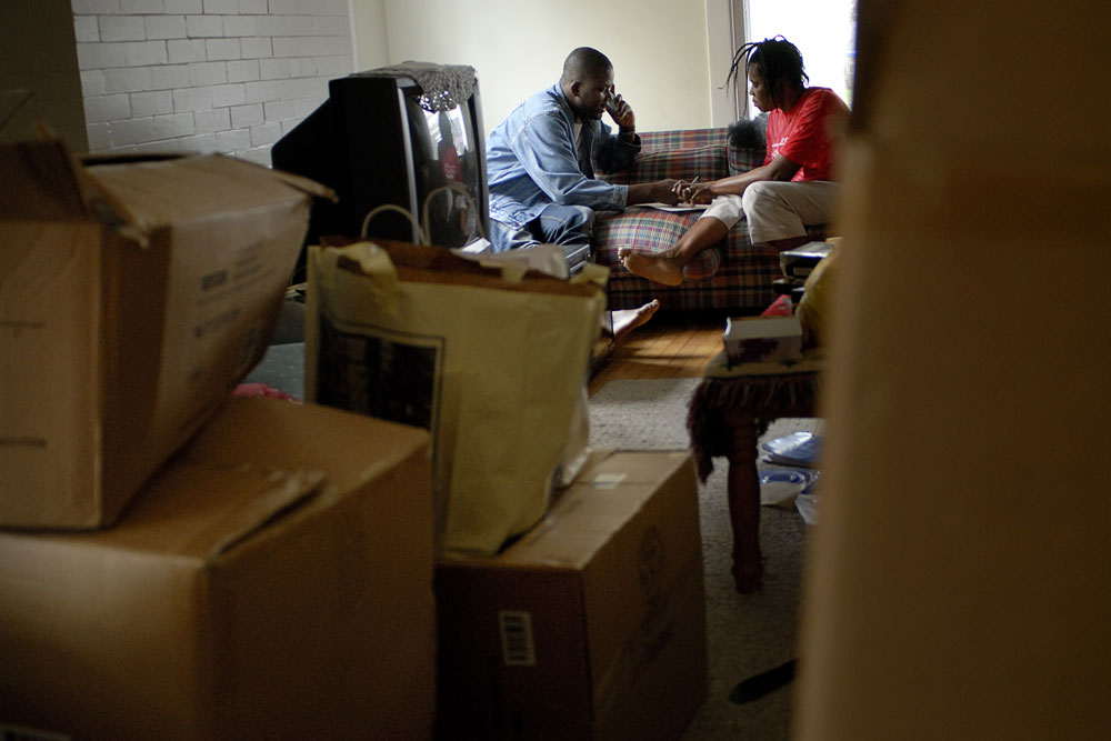 Lamin and Victoria discuss their impending move amid all their boxes.