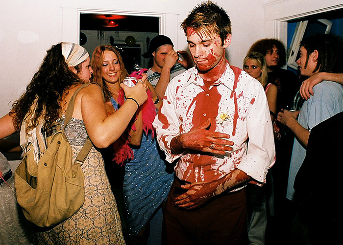 Brian Humerkowzer, in his 'blood, trash, disaster' themed clothes, poses with his friend Emily Heilsman at 'Lancaster Prom,' a street party thrown by members of the 'hipster crowd' at Ohio University. The prom was held as an alternative to more traditional street parties held in Athens, Ohio.