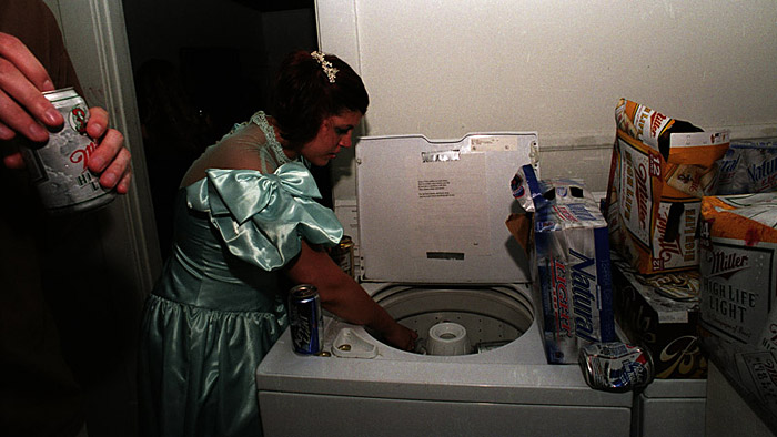 A washing machine serves as a container for ice and beer at Lancaster Prom on May 5, 2004. Lancaster Prom is a street party thrown by members of the 'hipster crowd' at Ohio University. The prom was held as an alternative to more traditional street parties held in Athens, Ohio.