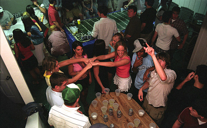 Members of various Greek organizations play flip cup (foreground) and beer pong (background) at the Delta Upsilon party barn. {quote}Well frat life...I don't know if it's a culture or a subculture,{quote} says Jim Velleta. {quote}I look at it as an organization that's part of OU that helps OU through philanthropic events. But I think those things get overshadowed by the parties, or the secrecy and rituals and secret handshakes.{quote}