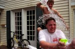Brian Veek dumps water on Nick {quote}Chops{quote} Dunston during their spring philanthropy event.