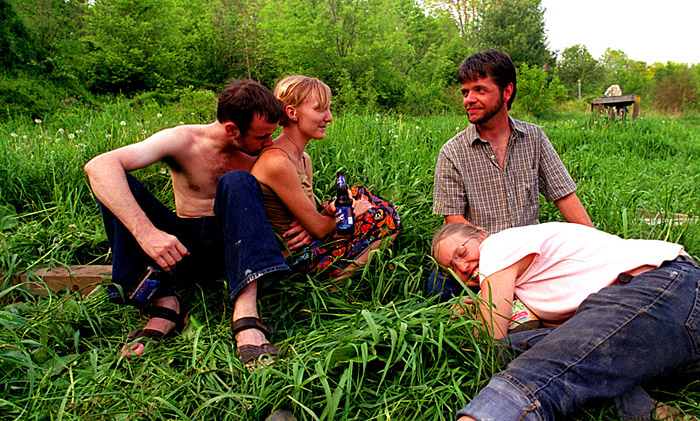 David, Erin, Hans and Kate take a break after finishing the new outhouse. {quote}I don't know, maybe this might be intense, but a lot of people talk about all these social problems and environmental problems, these really big issues,{quote} states Andree. {quote}It seems like if people started out with a nice firm base then there wouldn't be so many larger issues.{quote}