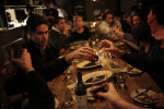 Diners toast at Girl and Goat.