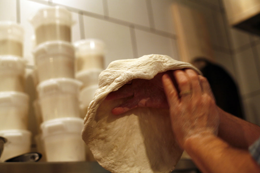 Tossing pizza dough at Great Lake.