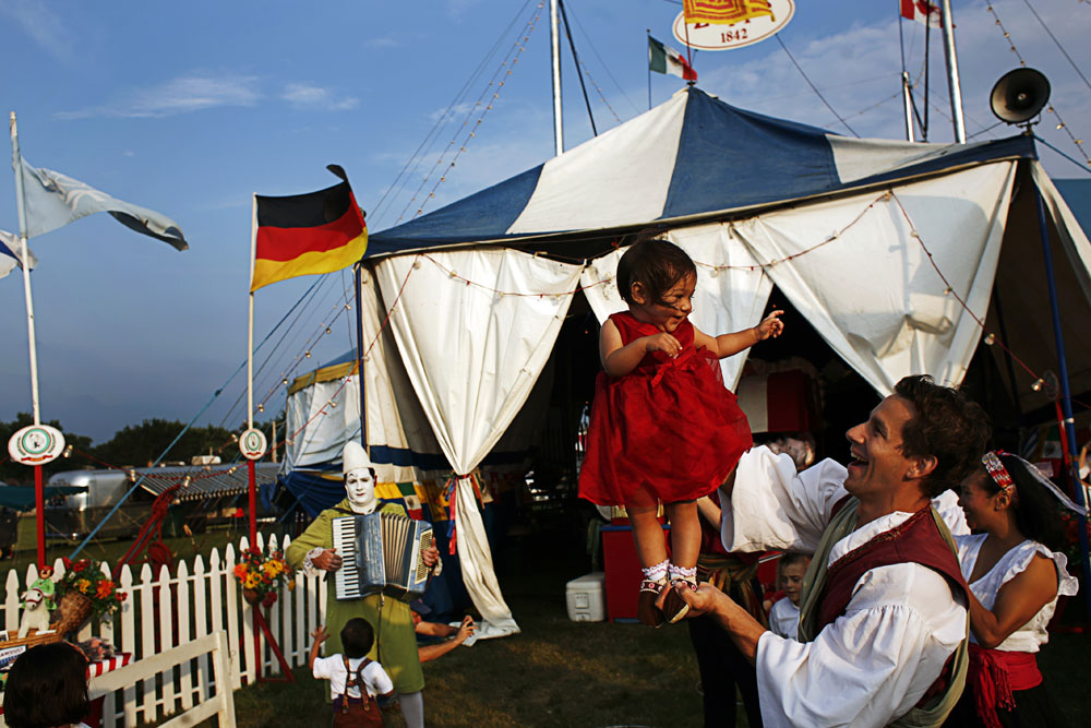 Carlo Gentile holds Giulia, 1, in front of the tent at The Zoppé family circus in Addison, Illinois.