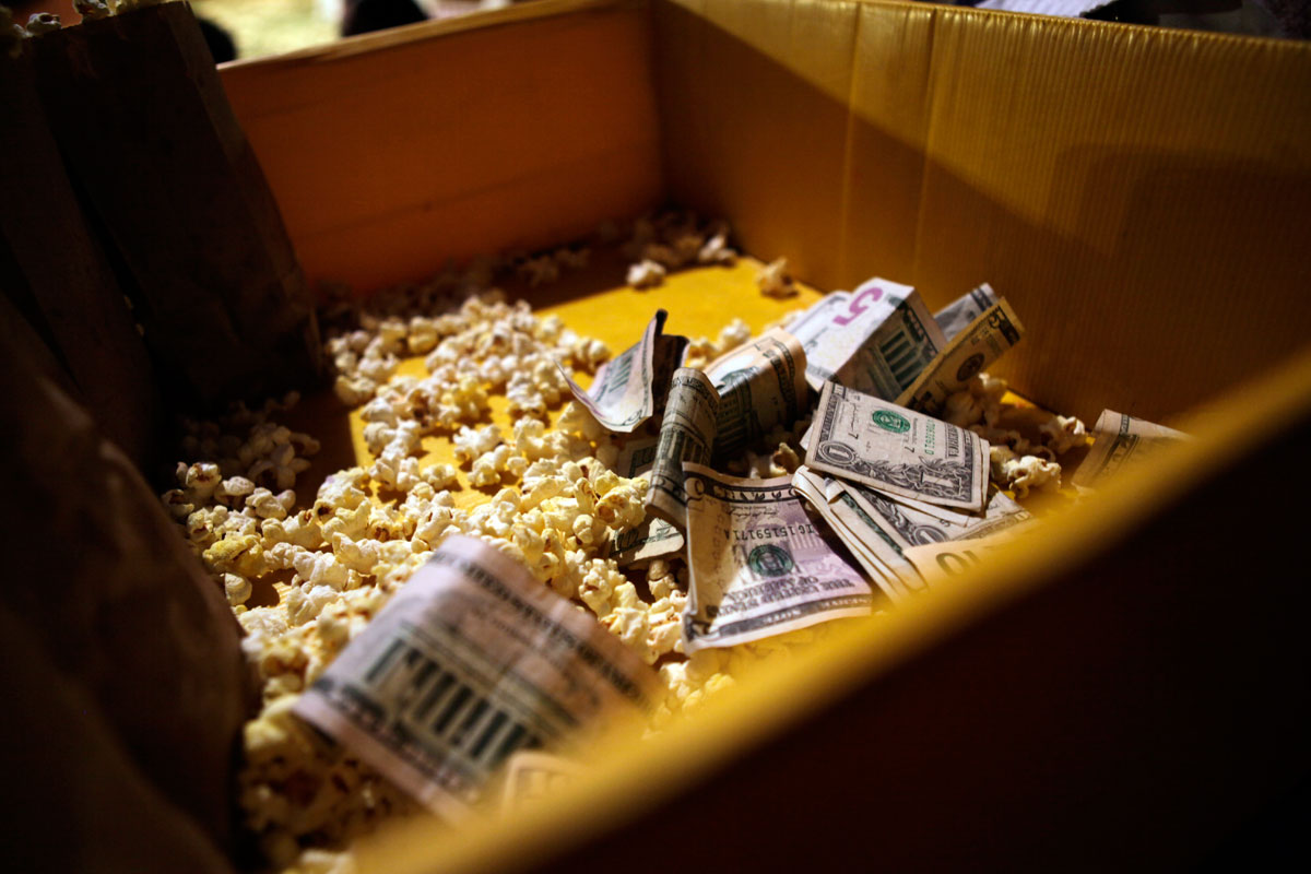 Popcorn mixes with moneycollected from popcorn sales during intermission at the Zoppe Family Circus