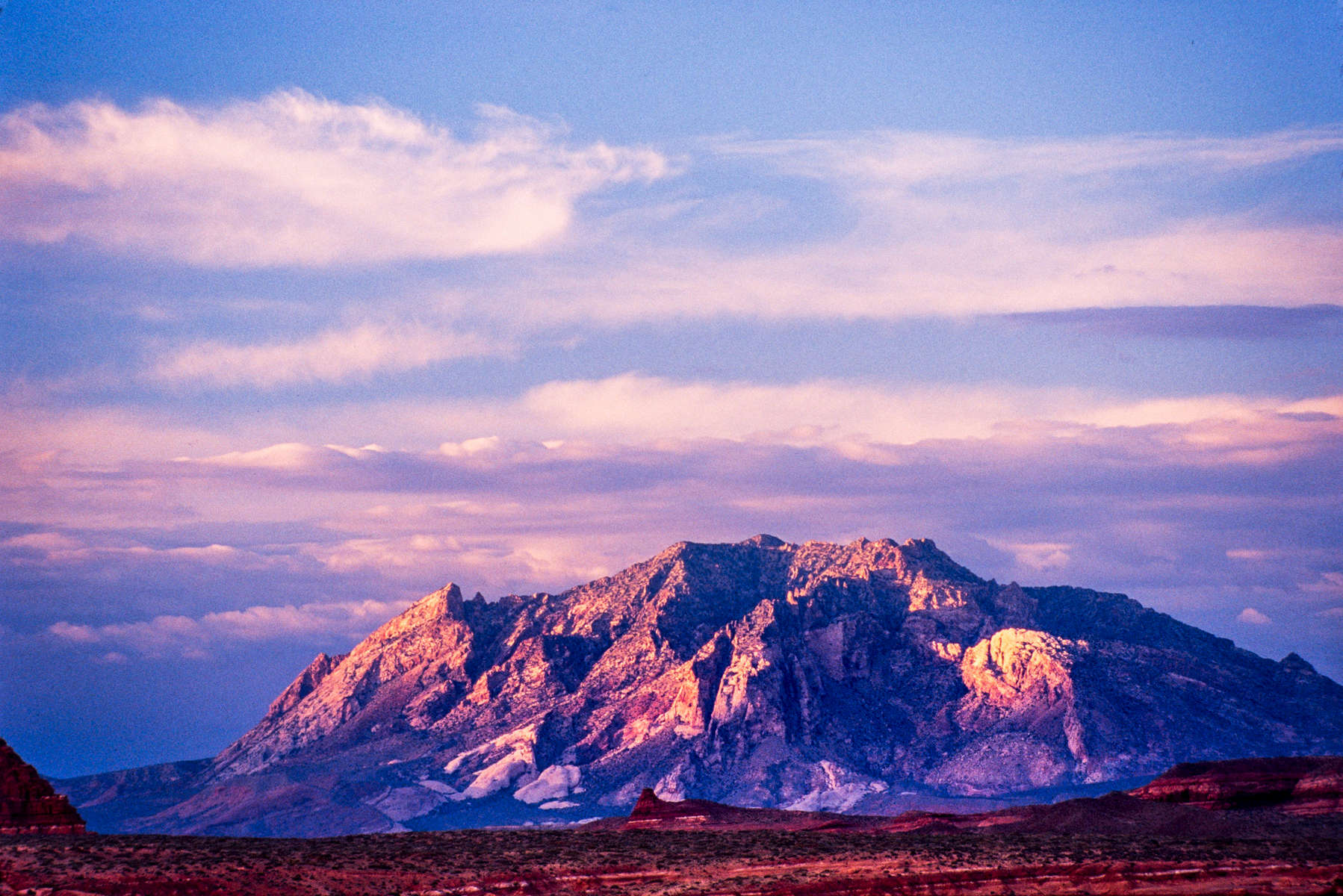 Rich colors are displayed on Mount Ellsworth in Garfield County, Utah, at sunset near Lake Powell's Bullfrog Bay.