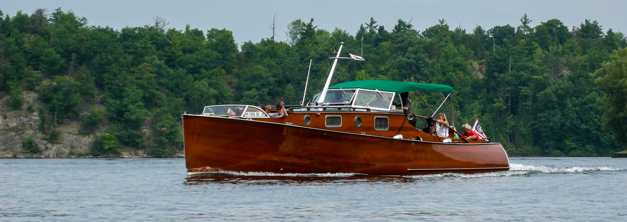 The wooden boat, Zipper, cruises the 1000 Islands