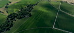 An aerial image of irrigated green fields with cloud shadows in Morril County, Nebraska.
