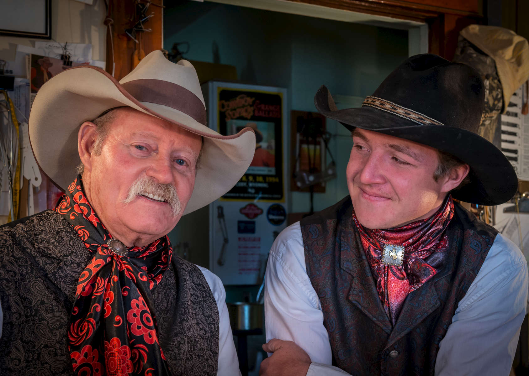 Ray Stokes and his carbon copy grandson, Justin Manning, take a moment  to relax in the saddle shop. Justin looks on, with great admiration and respect, for his grandfather.