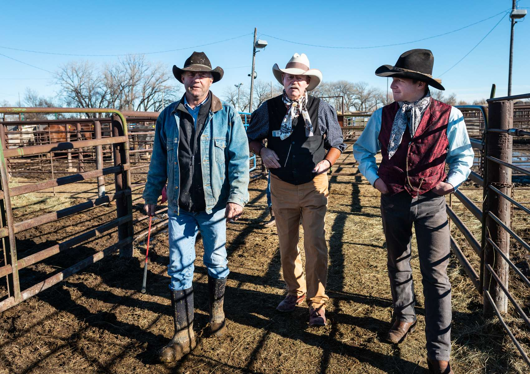 From Left, Rick Toczek,Ray Stokes, and Justin Manning walk through the pens at the Gordon Livestock Market, Gordon Nebraska.