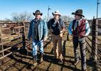 From Left, Rick Toczek,Ray Stokes, and Justin Manning walk through the pens at the Gordon Livestock Market, Gordon Nebraska.